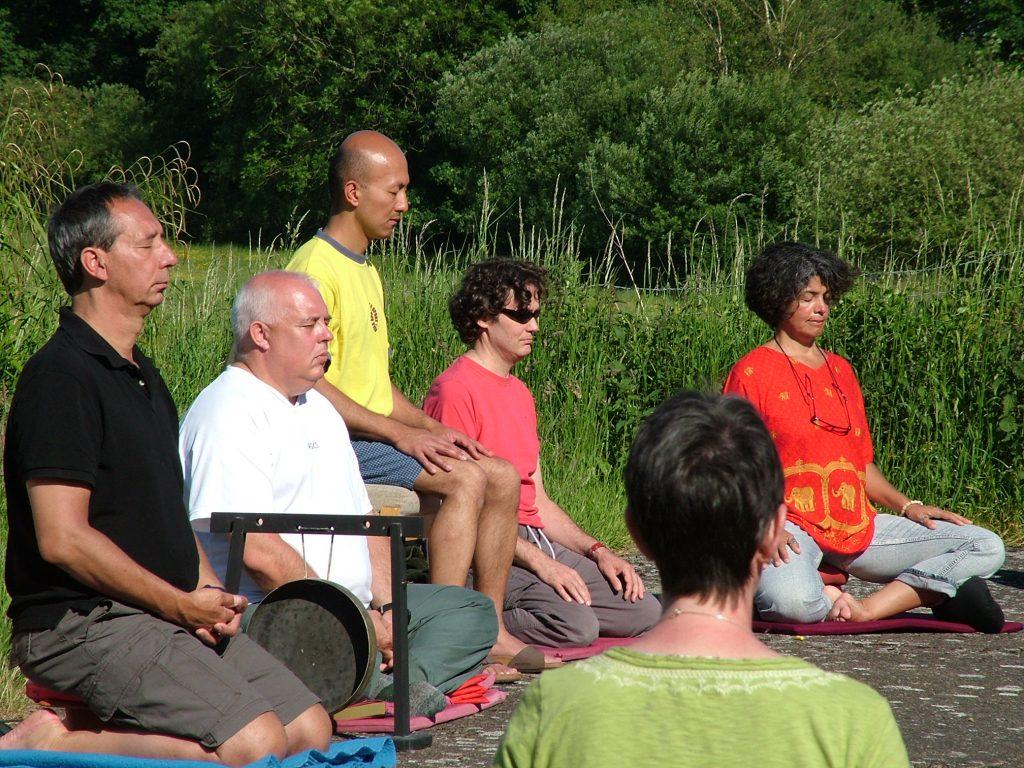 People meditating outside