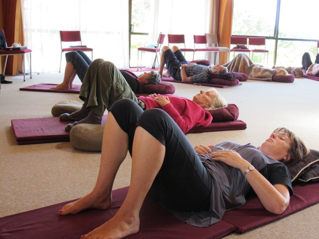 people lying down meditating